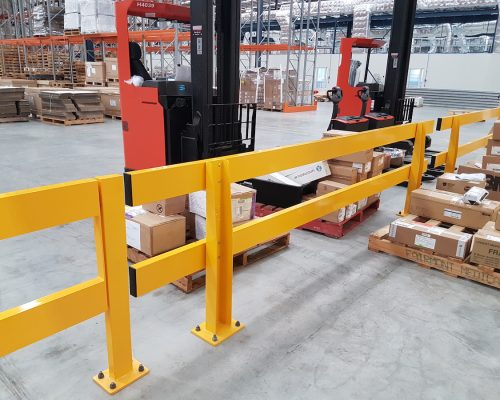 Verge safety barriers. Forklift barrier in large warehouse